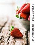 fresh fruit. strawberries on... | Shutterstock . vector #1412834657