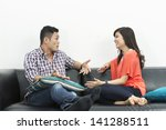yound and happy chinese couple... | Shutterstock . vector #141288511