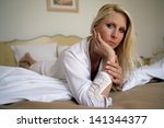 woman lying on a bed | Shutterstock . vector #141344377