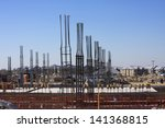 Construction site with concrete foundation and steel rebar - stock photo