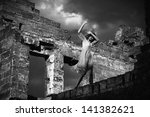 Black and white portrait of the afraid woman in the ruined building - stock photo