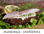 Stock photo sandwich with herring red onion rye bread on a brown table tradition danish open sandwich 1414025411