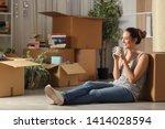 happy tenant resting drinking... | Shutterstock . vector #1414028594