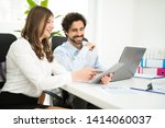 smiling business people using a ... | Shutterstock . vector #1414060037