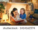 family bedtime. mom and child... | Shutterstock . vector #1414162574