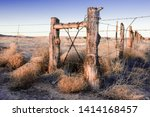 Wooden Fence With Barbed Wire...