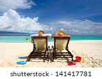 couple on a tropical beach at... | Shutterstock . vector #141417781