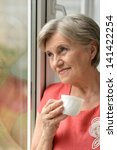 portrait of an attractive older ... | Shutterstock . vector #141422254