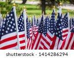 american flags on a green grass   Shutterstock . vector #1414286294
