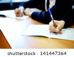 male hands writing task while... | Shutterstock . vector #141447364