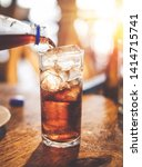 closeup cola filling into the... | Shutterstock . vector #1414715741