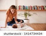 loving mother with newborn baby ... | Shutterstock . vector #1414734434