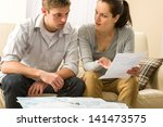 worried couple talking about... | Shutterstock . vector #141473575