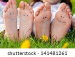children laying on grass.... | Shutterstock . vector #141481261