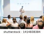 male speaker giving a talk in... | Shutterstock . vector #1414838384
