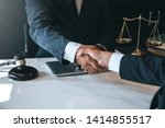 Stock photo businessman shaking hands to seal a deal with his partner lawyers or attorneys discussing a 1414855517