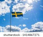 Swedish Flag On Blue Sky White...