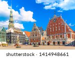 Small photo of View of the Old Town Ratslaukums square, Roland Statue, The Blackheads House and St Peters Cathedral against blue sky in Riga, Latvia. Summer sunny day.