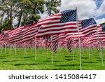 american flags on a green grass   Shutterstock . vector #1415084417