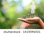 hand holding money coins saving ... | Shutterstock . vector #1415096531