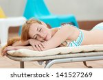 side view of a smiling young... | Shutterstock . vector #141527269