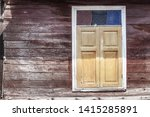 yellow wooden windows on the... | Shutterstock . vector #1415285891