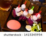 Stock photo canapes of pickled herring grated beets onions and rye bread served with quail egg and sauce 1415345954