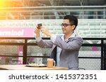 happy asian businessman selfie... | Shutterstock . vector #1415372351