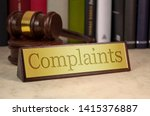 Stock photo golden sign with gavel and complaints 1415376887