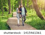 Young Couple Strolling In The...