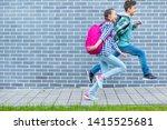 two happy schoolchildren with... | Shutterstock . vector #1415525681