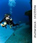 underwater photographer looking ... | Shutterstock . vector #14155546