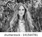 Beautiful young woman in summer garden. Beauty summertime - stock photo