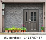 Gray Front Door With Small...