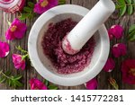 Stock photo rugosa rose petals crushed with cane sugar in a mortar top view 1415772281