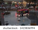 Small photo of Tokyo, Japan - November 25, 2012 : The pedestrian crossing and seeing so many people, crowds passing over from one side to the other is magical, it looks like a game. A small japanese bus passes by