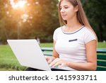young woman using her laptop... | Shutterstock . vector #1415933711