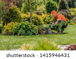Professional Garden Worker. Caucasian Gardener and the Backyard Maintenance. Agriculture Industry Theme. - stock photo