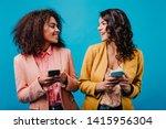 adorable african girl texting... | Shutterstock . vector #1415956304