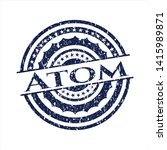 grunge emblem with atom text... | Shutterstock .eps vector #1415989871