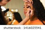 Makeup Artist Draws Arrows On...
