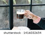 cropped shot of man holding a... | Shutterstock . vector #1416032654