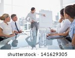 businesswoman pointing at a... | Shutterstock . vector #141629305