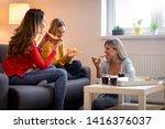 three female friends chatting... | Shutterstock . vector #1416376037