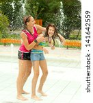 Teenage Girls Having Fun In Th...