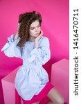 curly hair girl in blue blouse... | Shutterstock . vector #1416470711