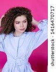 curly hair girl in blue blouse... | Shutterstock . vector #1416470717