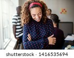 laughing young female designer... | Shutterstock . vector #1416535694