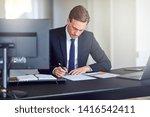 businessman sitting alone at... | Shutterstock . vector #1416542411