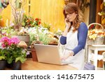 smiling mature woman florist... | Shutterstock . vector #141675475